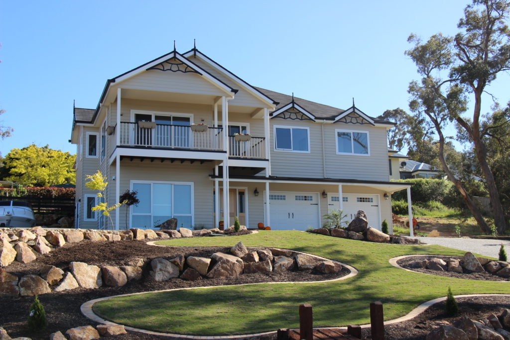 Front View of Hershey Heights - Americans Style home with Ashphalt Shingle roof built by Farm Houses of Australia
