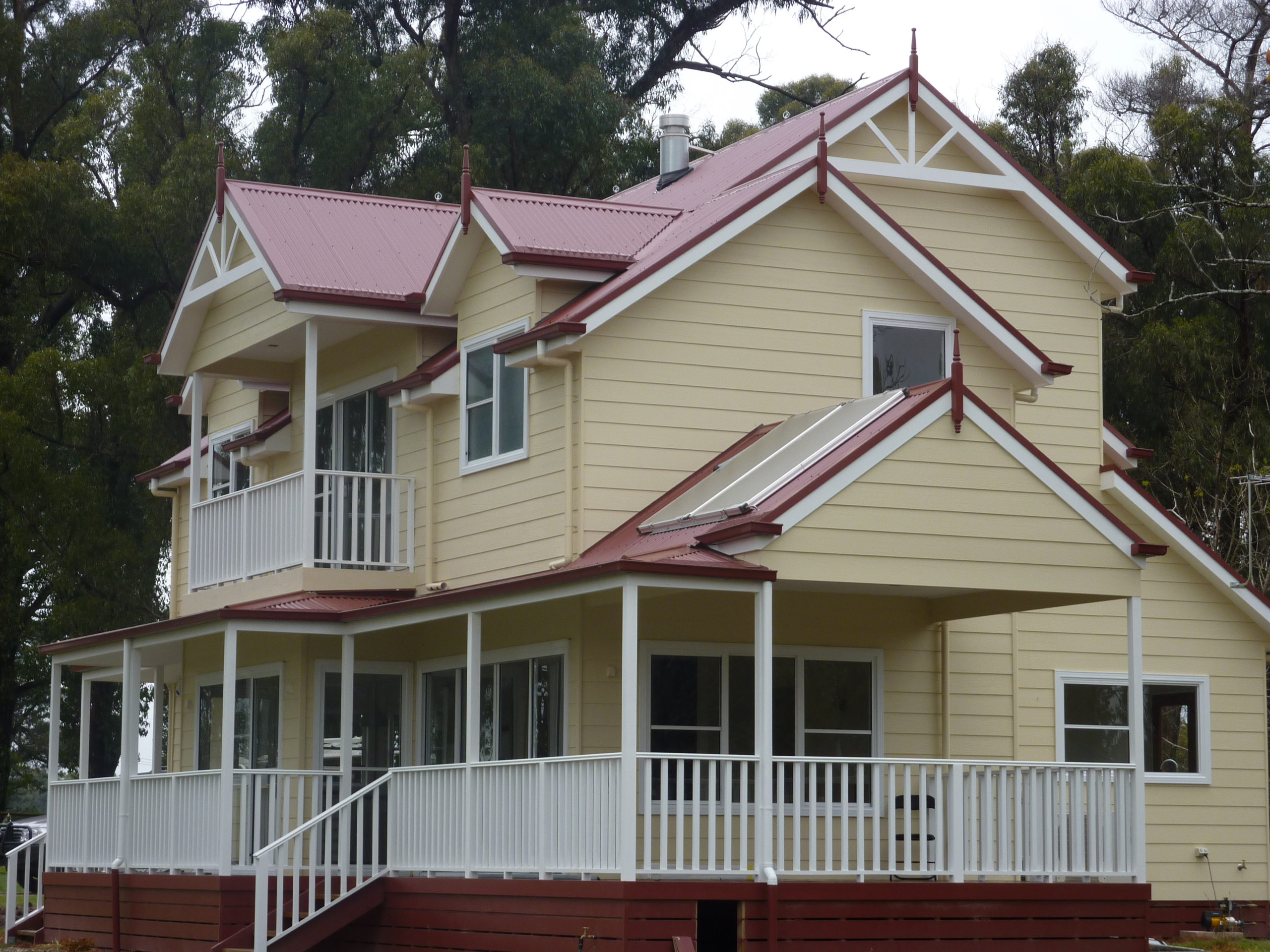 Kinglake - Finials and fenestrations adorn the dormers and gables, and timber balustrades built by Farm Houses of Australia