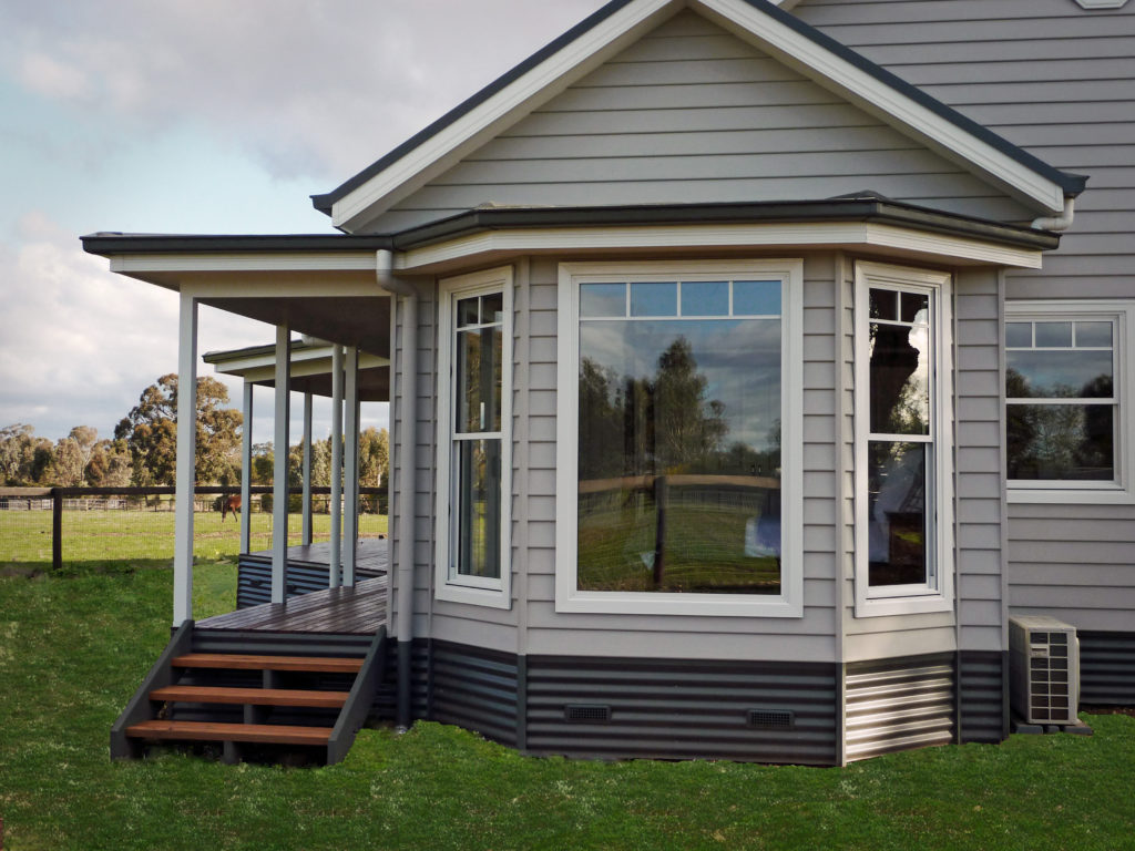 Penryhol - Bay windows to the kitchen and master bedroom take in property views built by Farm Houses of Australia